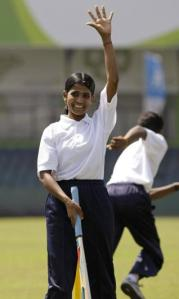 In this file photo a former Sri Lankan girl combatant reacts during a cricket game in Colombo, Sri Lanka. AP