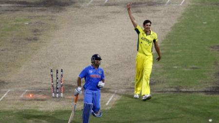 Australia's Mitchell Starc celebrates after India's captain MS Dhoni was run out by Glenn Maxwell during their Cricket World Cup semi-final match in Sydney