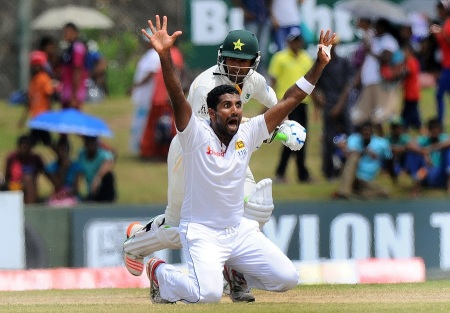 Sri Lankan cricketer Dhammika Prasad makes an unsuccessful appeal for the wicket of Pakistan cricketer Asad Shafiq during the fourth day of the opening Test match between Sri Lanka and Pakistan at the Galle International Cricket Stadium in Galle on June 20, 2015. AFP PHOTO/ Ishara S. KODIKARA        (Photo credit should read Ishara S. KODIKARA/AFP/Getty Images)