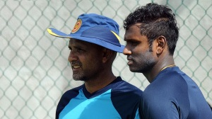 Sri Lanka cricket team captain Angelo Mathews (R) and team coach Marvan Atapattu chat during a practice session at the Galle International Cricket Stadium in Galle on June 15, 2015. Sri Lanka and Pakistan will play three Tests, five One-Day Internationals and two T20 Series in Sri Lanka between June 17 to August 1. The first Test between Pakistan and Sri Lanka will be played on June 17 at the Galle International Cricket Stadium in Galle. AFP PHOTO/ Ishara S. KODIKARA        (Photo credit should read Ishara S.KODIKARA/AFP/Getty Images)