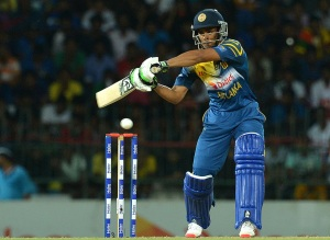 Sri Lankan cricketer Dhananjaya de Silva plays a shot during the first Twenty20 International cricket match between Sri Lanka and Pakistan at The R Premadasa International Cricket Stadium in Colombo on July 30, 2015. AFP PHOTO / ISHARA S KODIKARA        (Photo credit should read Ishara S.KODIKARA/AFP/Getty Images)
