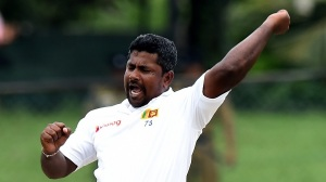 Sri Lankan cricketer Rangana Herath celebrates after dismissing West Indies cricketer Kemar Roach during the final day of their second Test cricket match between Sri Lanka and the West Indies at The P. Sara Oval Cricket Stadium in Colombo on October 26, 2015. AFP PHOTO/ Ishara S. KODIKARA        (Photo credit should read Ishara S.KODIKARA/AFP/Getty Images)