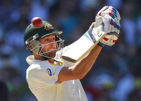 MELBOURNE, AUSTRALIA - DECEMBER 28: Nathan Lyon of Australia swings at the ball during day three of the Fourth Ashes Test Match between Australia and England at Melbourne Cricket Ground on December 28, 2013 in Melbourne, Australia. (Photo by Michael Dodge/Getty Images)