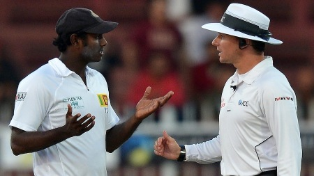 Sri Lanka cricket team captain Angelo Mathews (R) speaks with the umpire RA Kettleborough during the final day of their third and final cricket Test match against Pakistan at the Sharjah International Cricket Stadium, in the Gulf emirate of Sharjah, on January 20, 2014. Pakistan pulled off a thrilling five-wicket win over Sri Lanka in the third and final Test in Sharjah, levelling the series at 1-1. AFP P PHOTO/ISHARA S. KODIKARA (Photo credit should read Ishara S.KODIKARA/AFP/Getty Images)