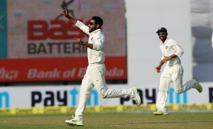 Ravindra Jadeja of India celebrates the wicket of Temba Bavuma of South Africa during day two of the 4th Paytm Freedom Trophy Series Test Match between India and South Africa held at the Feroz Shah Kotla Stadium in Delhi, India on the 4th December 2015 Photo by Ron Gaunt / BCCI / SPORTZPICS