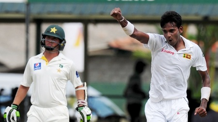 Sri Lankan cricketer Dushmantha Chameera (R) celebrates the dismissal of Pakistan cricketer Zulfiqar Babar during the opening day of the second Test between Sri Lanka and Pakistan at the P. Sara Oval Cricket Stadium in Colombo on June 25, 2015. Pakistan captain Misbah-ul Haq won the toss and elected to bat in the second Test against Sri Lanka at the P. Sara Oval in Colombo. AFP PHOTO / LAKRUWAN WANNIARACHCHI (Photo credit should read LAKRUWAN WANNIARACHCHI/AFP/Getty Images)