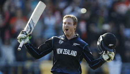 New Zealand's Martin Guptill celebrates after scoring a double century while batting against the West Indies during their Cricket World Cup quarterfinal match in Wellington, New Zealand, Saturday, March 21, 2015. (AP Photo/NZ Herald, Mark Mitchell)