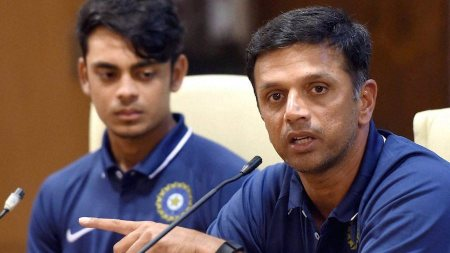 Mumbai: India's Under-19 coach Rahul Dravid along with team captain Ishan Kishan (L) during a press conference in Mumbai on Tuesday. PTI Photo by Mitesh Bhuvad (PTI1_19_2016_000309B)