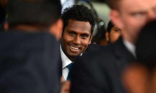 Sri Lankan T20 cricket captain Angelo Mathews (C) looks on during a departure ceremony in Colombo on March 8, 2016. Sri Lankan cricket Team departure to India for the ICC T20 World Cup Tournament. Defending champions Sri Lanka said Lasith Malinga was stepping down as captain of their World Twenty20 side March 8, after the team's disastrous Asia Cup showing, with Angelo Mathews to skipper the team in India. The announcement comes only hours after Sri Lanka's sports minister sacked the country's cricket selectors and appointed a new panel headed by former player Aravinda de Silva. / AFP PHOTO / ISHARA S.KODIKARA