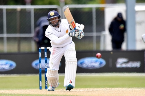 Kusal Mendis of Sri Lanka plays a shot during day four of the first International Test cricket match between New Zealand and Sri Lanka at University Oval in Dunedin on December 13, 2015. AFP PHOTO / MARTY MELVILLE / AFP / Marty Melville (Photo credit should read MARTY MELVILLE/AFP/Getty Images)