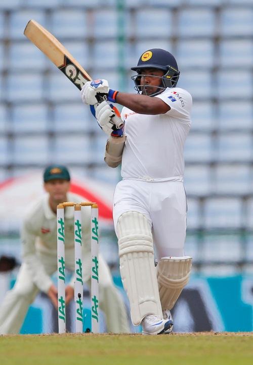 Sri Lanka's Rangana Herath plays a shot on day four of the first test cricket match against Australia in Pallekele, Sri Lanka, Friday, July 29, 2016. (AP Photo/Eranga Jayawardena)