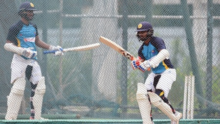 Sri Lanka cricketers Kaushal Silva (R) and Dimuth Karunaratne bat in the nets during a practice session at the  R. Premadasa Cricket Stadium in Colombo on July 15, 2016. Australia and Sri Lanka play three Test, five One-Day Internationals and Two T20 series matches between July 26 and September 9, with the first Test played from July 26 at the Pallekele International Cricket Stadium in Pallekele. / AFP / ISHARA S.KODIKARA        (Photo credit should read ISHARA S.KODIKARA/AFP/Getty Images)