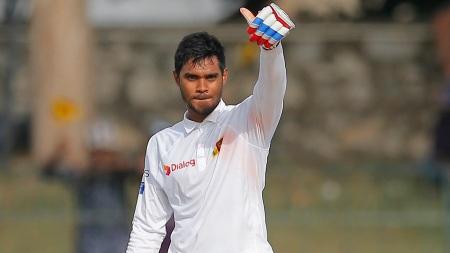 Sri Lanka's Dhananjaya de Silva celebrates scoring a hundred during the first day of their third test cricket match against Australia in Colombo, Sri Lanka, Saturday, Aug. 13, 2016. (AP Photo/Eranga Jayawardena)