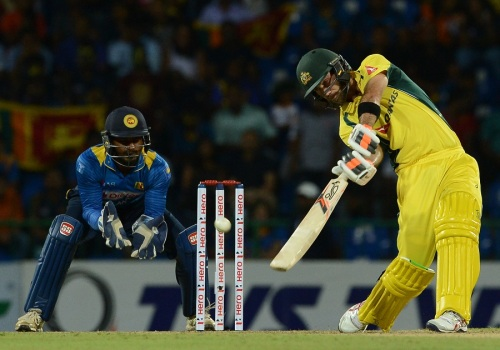 Australia's Glenn Maxwell (R) is watched by Sri Lanka's wicketkeeper Kusal Perera as he hits a ball to the boundary during the first T20 international cricket match between Sri Lanka and Australia at the Pallekele International Cricket Stadium in Pallekele on September 6, 2016. / AFP / LAKRUWAN WANNIARACHCHI (Photo credit should read LAKRUWAN WANNIARACHCHI/AFP/Getty Images)