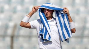 England's Joe Root uses a towel as a sun shade on the first day of their first cricket test match against Bangladesh in Chittagong, Bangladesh, Thursday, Oct. 20, 2016. (AP Photo/A.M. Ahad)