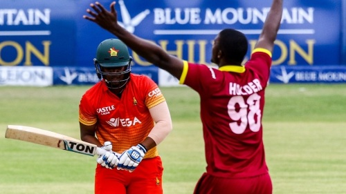 Zimbabwe's batsman Chamunorwa Chibhabha looses his wicket to captain Jason Holder during the sixth match in the Blue Mountain Achilleion tri-series played between West Indies and hosts Zimbabwe on November 26, 2016 at the Queens Sports Club in Bulawayo. / AFP / Jekesai Njikizana (Photo credit should read JEKESAI NJIKIZANA/AFP/Getty Images)