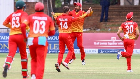 Zimbabwe batsman Sikanda Raza Butt (C) celebrates a wicket during the sixth match in the Blue Mountain Achilleion tri-series played between West Indies and hosts Zimbabwe at the Queens Sports Club in Bulawayo, November 25, 2016. / AFP / Jekesai Njikizana (Photo credit should read JEKESAI NJIKIZANA/AFP/Getty Images)