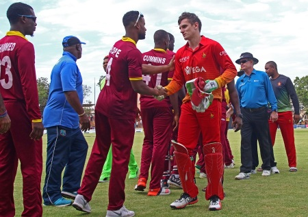 Zimbabwe's wicket keeper Peter Moor (R) shakes hands with West Indies batsman Shai Hope after Zimbabwe defeated West Indies during the third tri-nation One Day International (ODI) cricket match between Zimbabwe and West Indies at Queens Sports Club in Bulawayo on November 19, 2016. / AFP / Jekesai Njikizana (Photo credit should read JEKESAI NJIKIZANA/AFP/Getty Images)