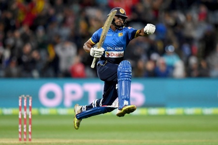 Asela Gunaratne of Sri Lanka celebrates scoring the winning run during the second Twenty20 cricket match between Australia and Sri Lanka at Kardinia Park in Geelong on February 19, 2017. / AFP / Mal Fairclough / -- IMAGE RESTRICTED TO EDITORIAL USE - STRICTLY NO COMMERCIAL USE -- (Photo credit should read MAL FAIRCLOUGH/AFP/Getty Images)